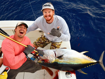 Stuart Clements and Brandon Wilder haul the year's heaviest bigeye tuna aboard the High Noon with Capt. Jah Nogues.  Photo courtesy of High Noon Sportfishing.