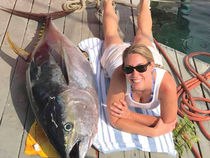 Keri Clavin rests up after battling a 191-pound yellowfin tuna.  It's the biggest rod-and-reel ahi reported to us so far this year.  Action aboard Bite Me 6 with Capt. Brad Damasco.  Photo courtesy of  Bite Me Sportfishing.