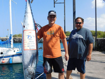 New ono leader on the Big-Fish ?L? ist, 75.5 pounds. Angler Jason Wong with Donny Kobashi on their boat of no name.  Photo courtesy of The Charter Desk at Honokohau Harbor.