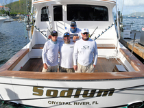 Top Boat, Sodium, with six blue marlin releases. L to R in front: Tyler Valles, Chad Damron,  Captain Randy Jendersee; in back, Travis Butters. Credit: Dean Barnes