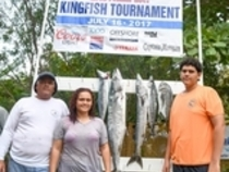 Seventeen year old Lawrence Aubain (far right) last year's largest kingfish winner. Credit: Dean Barnes