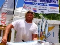 Matthew Bryan with his Largest Kingfish. Credit: Dean Barnes