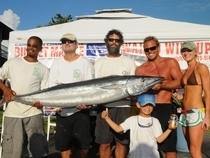 2012 Virgin Islands Game Fishing Club's Wahoo Windup Winner. L to R: Clive Mahabir, Rob Richards, James MacNeil, Clay Gaffney and Sarah Faist, with Robbie Richards in front, stand with Mahabir's winning 91.8-pound wahoo officially weighed in by DP